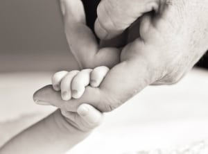 holding baby's hand